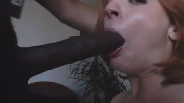Redhead slut and big black cock to suck and fuck