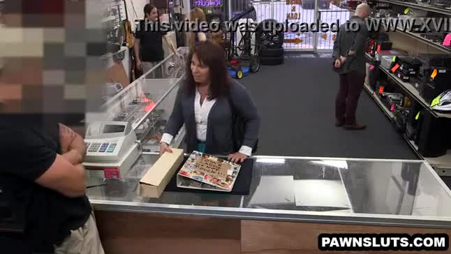 Brunette tries to sell some cards to the pawn shop